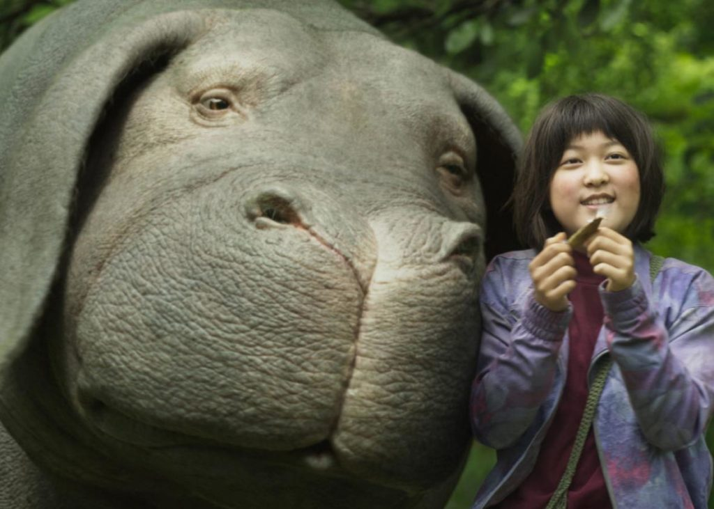 OKJA – Fantasy Turns to Reality About Corporate Greed, Consumerism, Ethical and Moral Judgment, and Saving A Lovable Mutant Super Pig